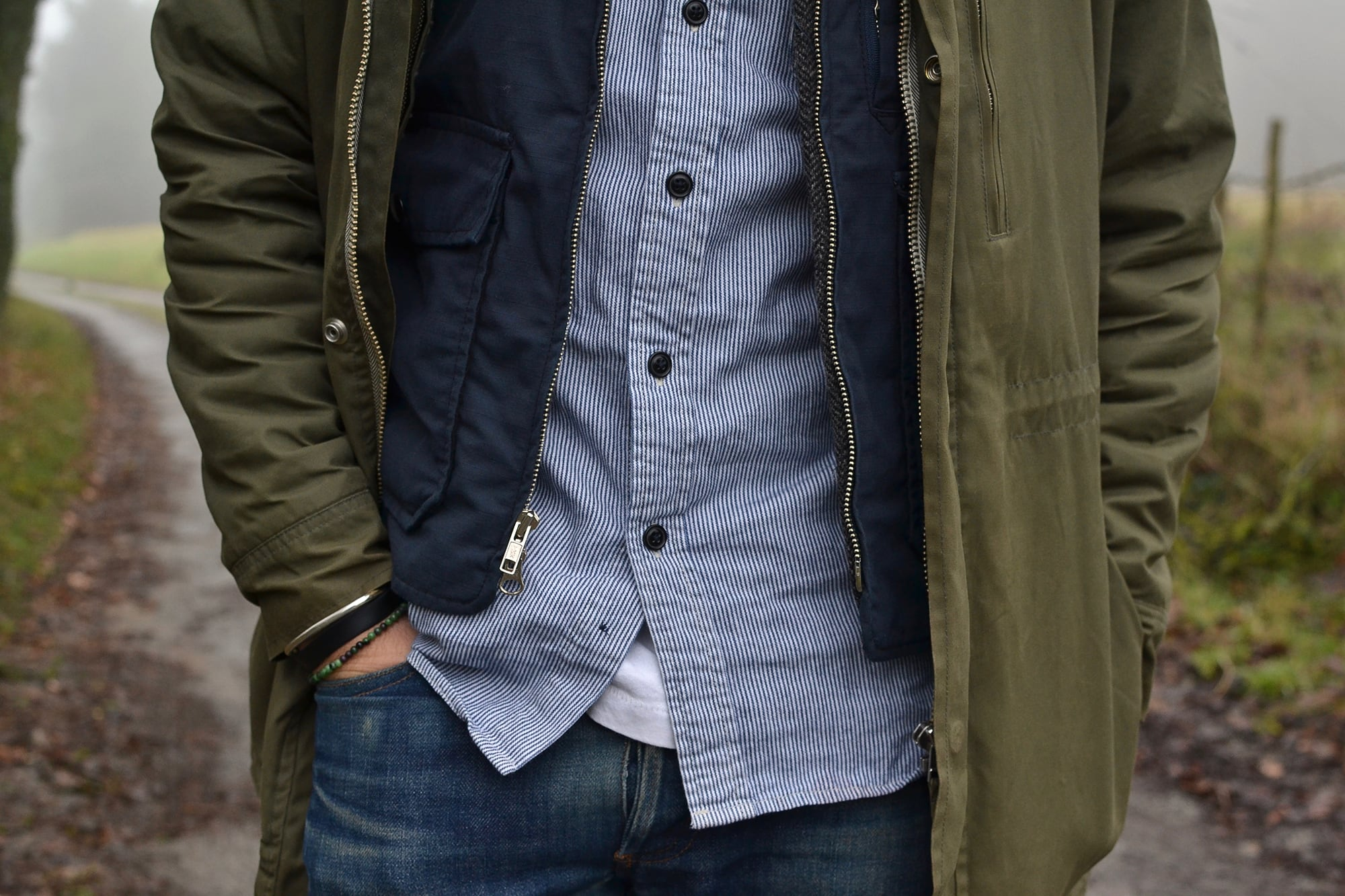 outfit in workwear style with visvim virgil boots , a parka norse projects lindisfarne and engineered garments gilet in tweed and ripstop