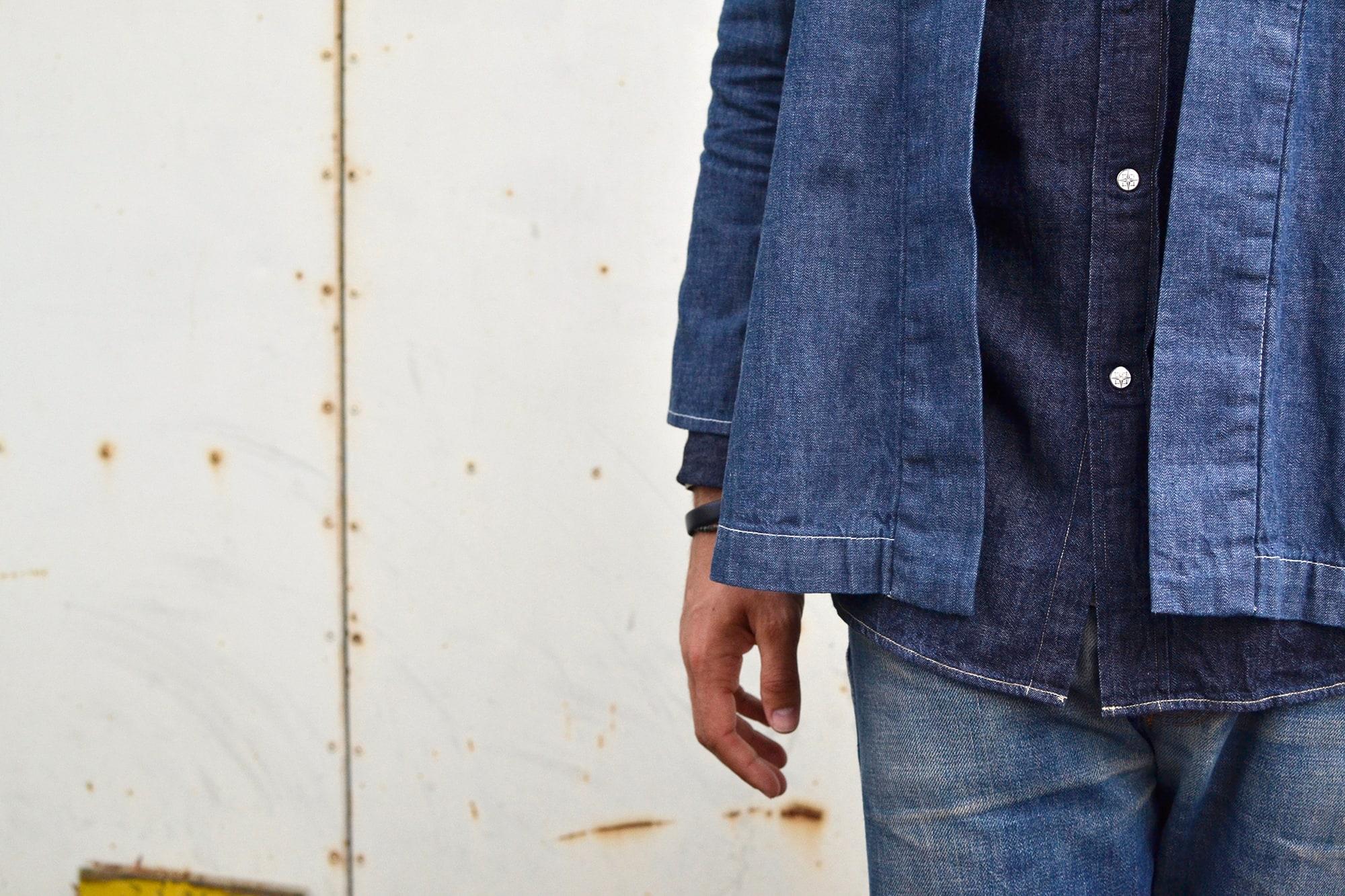 comment porter une noragi Visvim avec un layering de denim et d'indigo et un jeans apc tapered