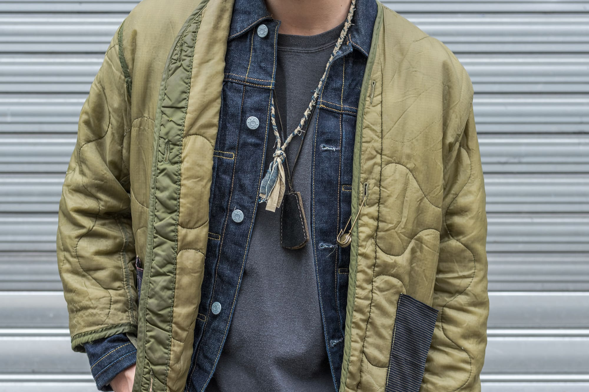 layering with trucker jacket type 1 and vintage m65 liner and some necklaces for men borali and laperruque