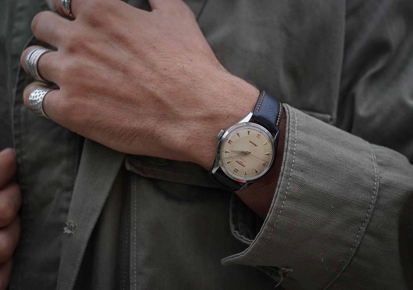 veste militaire vintage et montre longines ancienne