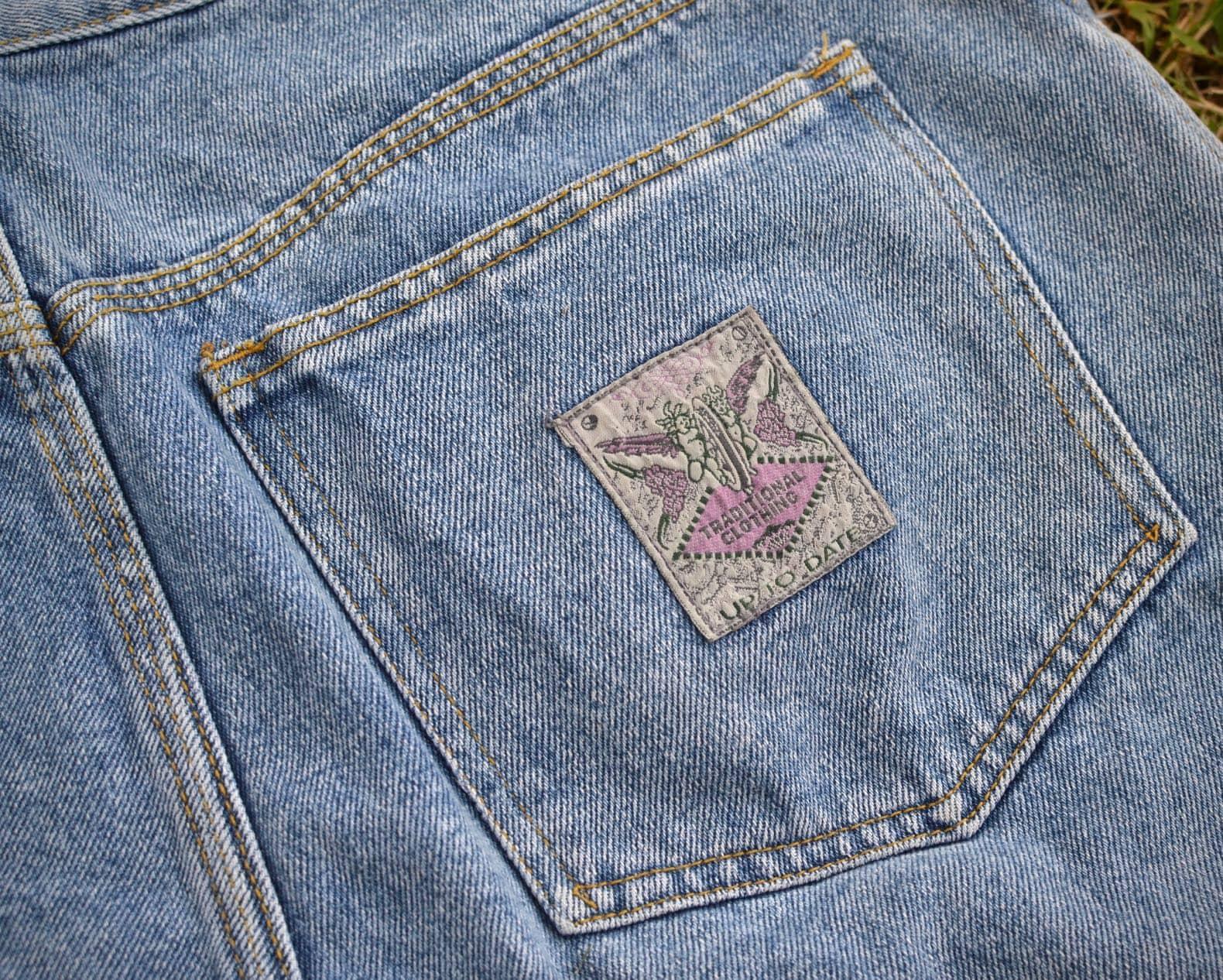 poche short jean ecusson