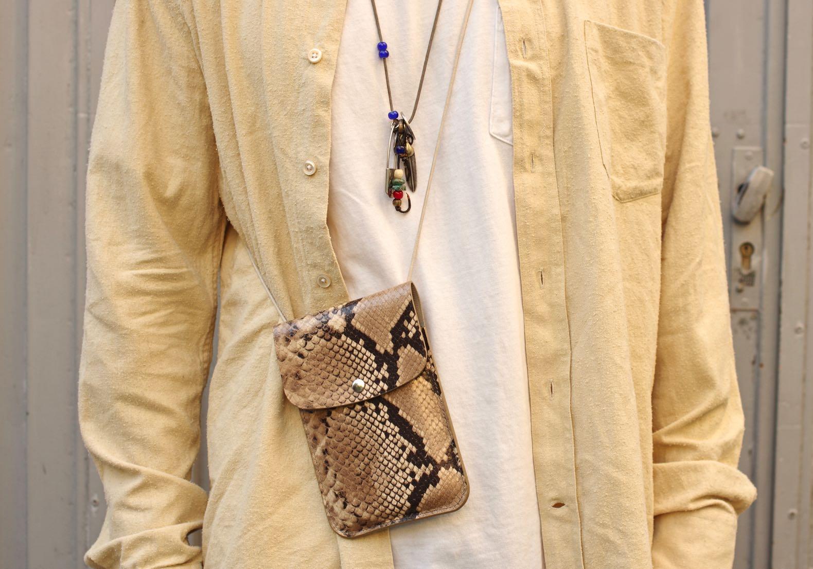laperruque leeather push bag python fake