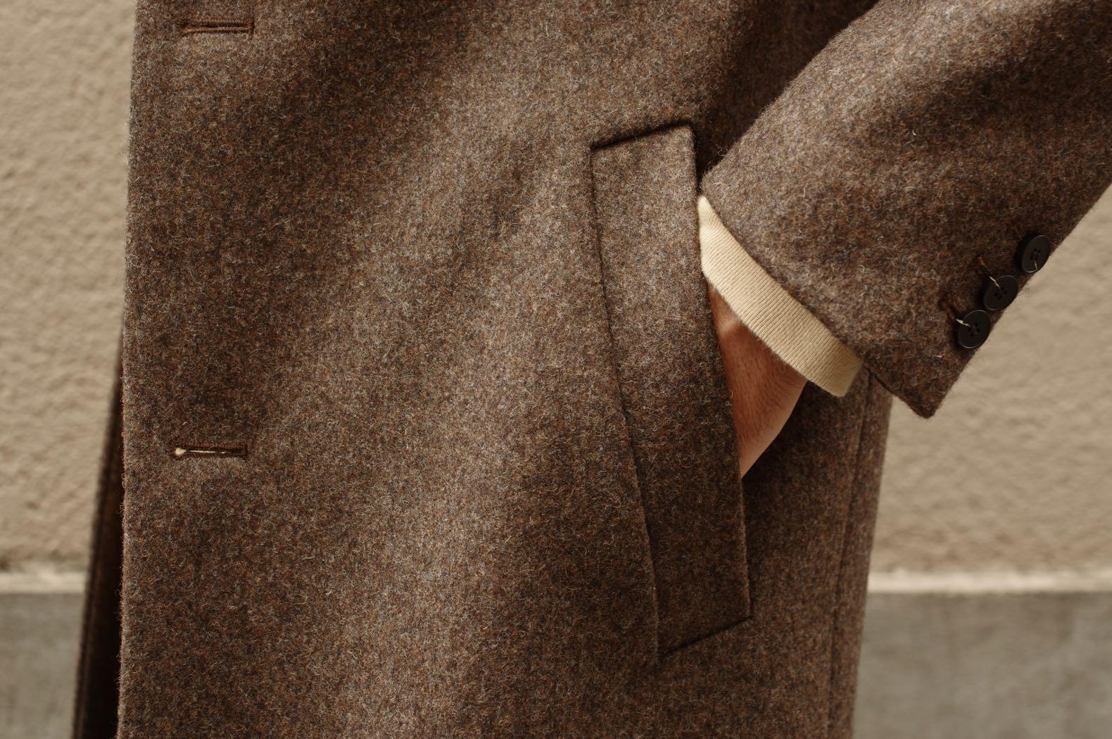 poche en biais manteau long laine homme